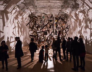 People in Cornelia Parker exhibition at the Whitworth, the installation of a shed frozen in midexplosion